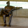 "A statue of Tal Wooten inside the Moore-Wooten Plaza urges visitors to Jolly Mill Park to ""Please sit, rest, get a hug.""<br /> Globe 