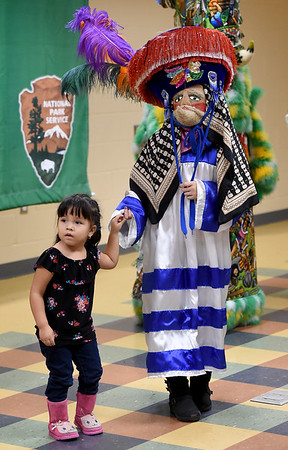Three-year-old Quetzali Rodriguez, of Pittsburg, leaves the udience to join The Chinelos Morelenses dancers, of Springdale, Ark. during Hispanic Heritage Day on Saturday at George Washington Carver National Monument. The event also featured arts and crafts, food and more.<br /> Globe | Laurie Sisk
