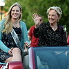 From the left: Parade Marshalls and former Joplin High Shool Homecoming Queens Mallory Cravens (2018) and Sara Van Fleet Newman (1954) greet the crowd during the 2019 JHS Homecoming Parade on Wednesday night on Main street.<br /> Globe | Laurie Sisk