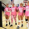 The 2019 Pink Out honorary coach and breast cancer survivor Stephanie Miller, second from the left:  is escorted by Carl Junction volleyball players, from the left: Dani Wrensch, Cortni Deem and Makenna Jones before the start of their match on Tuesday night at CJHS. The event, in its 12th year, raised $3,975 to benefit the Hope 4 You Breast Cancer Foundation.<br /> Globe | Laurie SIsk