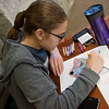 Eden Laws, a Missouri Southern sophomore from Joplin uses crayons and a coloring sheet provided by the MSSU counseling office at a relaxation station at Spiva Library on Tuesday.<br /> Globe | Roger Nomer