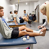 Jennifer Lallemand, certified athletic trainer at Crowder, tapes Ethan Merino's, freshman soccer player at Crowder, ankle on Tuesday in the new training room of the Freeman Fieldhouse.<br /> Globe | Roger Nomer