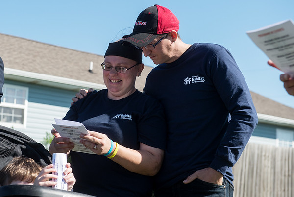 """Kristen Asbell and Dillon Sprague participate in the """"Prayer for Shelter"""" during the groundbreaking for their Habitat home on Monday in Joplin."""