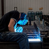 Justin Howerton, welder and fabricator at Cardinal Scale, welds a large truck scale at the company on Wednesday.<br /> Globe | Roger Nomer