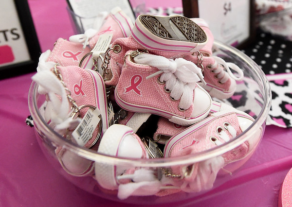 Tiny high top tennis shoe key chains sit for sale on a table during the The 2019 Pink Out on Tuesday night at Carl Junction High School. The event, in its 12th year, raised $3,975 to benefit the Hope 4 You Breast Cancer Foundation.<br /> Globe | Laurie Sisk
