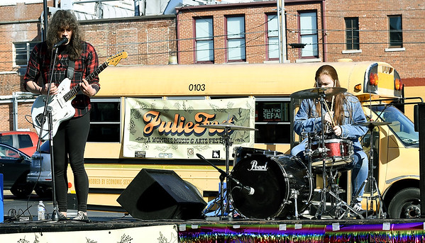 The band Tiger Millionaire performs for the crowd during JulieFest, a women's music and arts festival on Saturday in the 500 block of North Joplin. The event included a variety of artists and musicians.<br /> Globe | Laurie Sisk