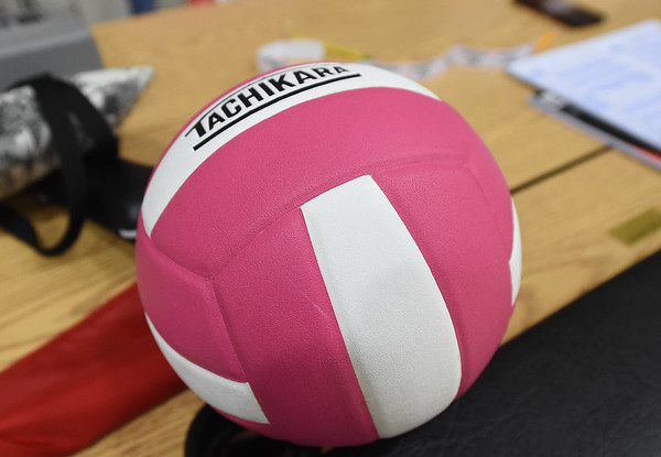 A pink and white volleyball sits on the scorer's table during the The 2019 Pink Out on Tuesday night at Carl Junction High School. The event, in its 12th year, raised $3,975 to benefit the Hope 4 You Breast Cancer Foundation.<br /> Globe   Laurie Sisk