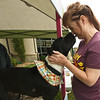 """Bambi,"" a pit bull mix, works the kissing booth as Kelly Cruzan reaps the rewards of the pup's affectionate nature during the Joplin Humane Society's Furry Fall Fest on Saturday at the shelter. The event featured games, treats, a photo booth and adoption specials. ""Bambi"" is available for adoption.<br /> Globe 