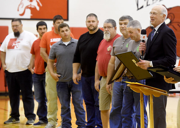 XXX, right, honors Liberal firefighters with a proclamation after helping battle the Liberal Elementary School fire recently.<br /> Globe   Laurie Sisk