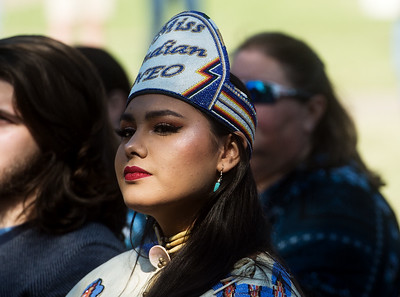 Ravyn Whitebird, NASA president and Miss Indian NEO, listens during the unveiling ceremony for the Centennial Tribal Monument on Monday at NEO. Globe | Roger Nomer