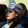 Ravyn Whitebird, NASA president and Miss Indian NEO, listens during the unveiling ceremony for the Centennial Tribal Monument on Monday at NEO.<br /> Globe | Roger Nomer