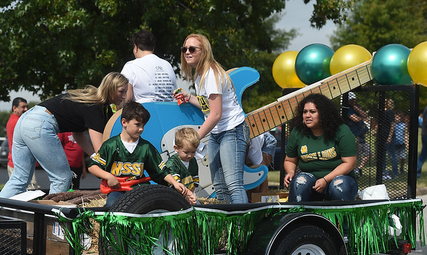 Representatives from the Campus Activities Board hand out candy from their float during Missouri Southern's 2019 Homecoming Parade on Saturday at MSSU.<br /> Globe   Laurie Sisk