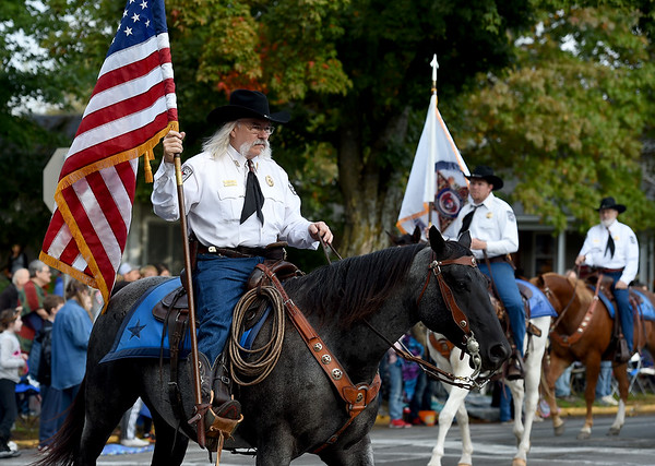 Col. Ron Millard leads the Jasper County Sheriff's Posse during the 53rd Annual Maple Leaf Parade in Carthage on Saturday.<br /> Globe | Laurie Sisk
