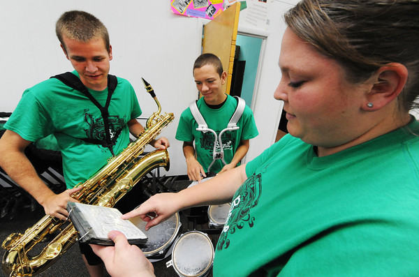 Quapaw (Okla.) High School senior Jesse Morton (left) on barisax and sophomore Jakob Way on quints listen as Sarah Fanning, band director, goes over a musical piece with them Friday afternoon, Sept. 13, 2013, at the school.<br /> Globe | T. Rob Brown