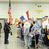 The crowd salutes and puts their hands over their hearts as the Joplin High School JROTC presents the colors during the Patriot's Day Veterans Award Ceremony Wednesday afternoon, Sept. 11, 2013, at the Missouri National Guard Armory on 32nd Street in Joplin. The event was sponsored by the MOAA Four State Chapter in cooperation with the Guard, the Missouri Veterans Association and the state of Missouri.<br /> Globe | T. Rob Brown