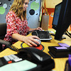 MSSU senior elementary education major Lydia McGriff works an on-campus job in the Career Services Center at the university library Wednesday afternoon, Sept. 4, 2013. McGriff said she earned scholarships to pay for her education.<br /> Globe | T. Rob Brown