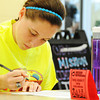 Globe | T. Rob Brown<br /> Sierra Gray, MSSU freshman undecided major of Ponca City, Okla., registers to vote Tuesday morning, Sept. 24, 2013, at the Lions Den in MSSU's Billingsly Student Center. Political science students and faculty are on a mission to help students register to vote.