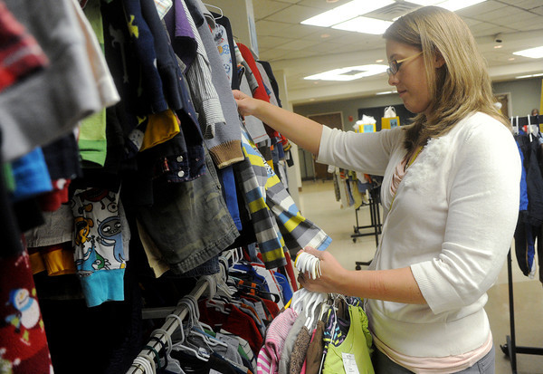 Globe/Roger Nomer<br /> Lindsey Van Leeuwen, Arma, shops at The Mom's Marketplace kid's consignment event at Pittsburg Memorial Auditorium on Monday afternoon.