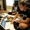 Globe/T. Rob Brown<br /> Joplin High School junior Molly Banwart (left) and senior Anna Banwart as they work on homework recently after school in their Joplin home.