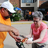 Vera Johnston (right), a Spring River Christian Village resident) gets a hot dog from Executive Director Scott King during the First Responders Picnic Sept. 12, 2013, at Spring River Christian Village in Joplin.<br /> Globe | T. Rob Brown