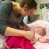 Globe/Roger Nomer<br /> Leslie Harris wakes up her daughter Delylah on her first birthday at Children's Mercy Hospital.