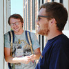 "MSSU sophomore English education major Josh Myers of Joplin (left) and junior history education major Zach Baughman of Carl Junction stand in the shade of columns outside the university library Wednesday afternoon, Sept. 4, 2013, as they discuss the cost of school, loans and ways to pay off school. ""Teachers don't make a whole lot,"" Baughman said. ""So the government is very helpful in supplementing your income. Teachers can get homes cheaper in revitalization areas through urban development (HUD).""<br /> Globe 