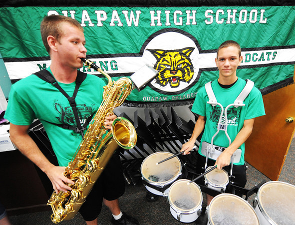 Quapaw (Okla.) High School senior Jesse Morton (left) on barisax and sophomore Jakob Way on quints practice in the music room Friday afternoon, Sept. 13, 2013, at the school.<br /> Globe | T. Rob Brown