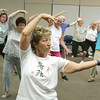 Globe/Roger Nomer<br /> Becky Browne guides her Tai Chi class through a form at the Freeman Business Center on Monday afternoon.  The class is sponsored by Freeman Advantage to help seniors exercise their mind and body.