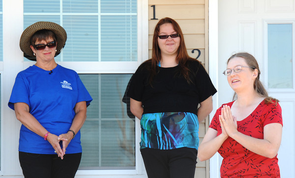 Emily Morrison (right), home owner, expresses her gratitude Thursday morning, Sept. 26, 2013, to Rebuild Joplin and all of the volunteers for helping her build her new home during a Rebuild Joplin Open House event.<br /> Globe | T. Rob Brown
