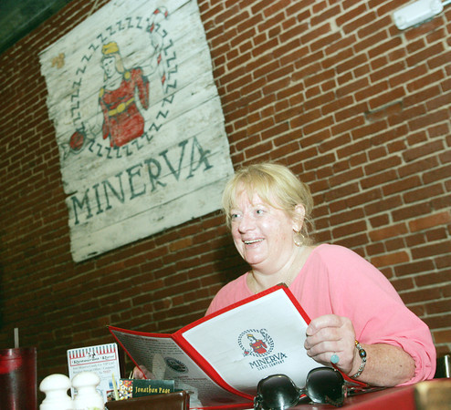 Globe/Roger Nomer<br /> Pamela Volkl, Wentworth, looks over the menu during lunch at the Minerva Candy Company.  The candy company is celebrating its 100th anniversary in Webb City.