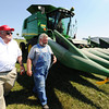 Congressman Billy Long (left) and Mark McMillin, a Schallert Seed employee and nephew of the owner, walk about a John Deere combine during Long's agriculture tour Friday afternoon, Sept. 6, 2013, at Schallert Seed in Purdy.<br /> Globe | T. Rob Brown