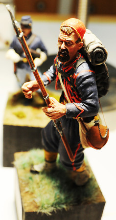 A detailed miniature of a member of the 9th New York Volunteer Infantry, known as Hawkin's Zouaves, who fought in Sharpsburg, Md., built, painted and based by Terry Barton of Pittsburg, Kan., Thursday afternoon, Sept. 26, 2013, in Barton's home. Barton said he researches his work to make it as historically accurate as possible with period uniforms and detailed bases. Some of his bases even incorporate actual grass from historic Civil War battlefields.<br /> Globe | T. Rob Brown
