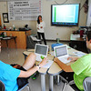 Joplin High School seniors in science research class (from left) seniors Matt Richman-Bennett and Sam Belnap ask questions of Laela Zaidi (center) as she gives a journal report on fruit fly research Thursday afternoon, Sept. 5, 2013.<br /> Globe | T. Rob Brown