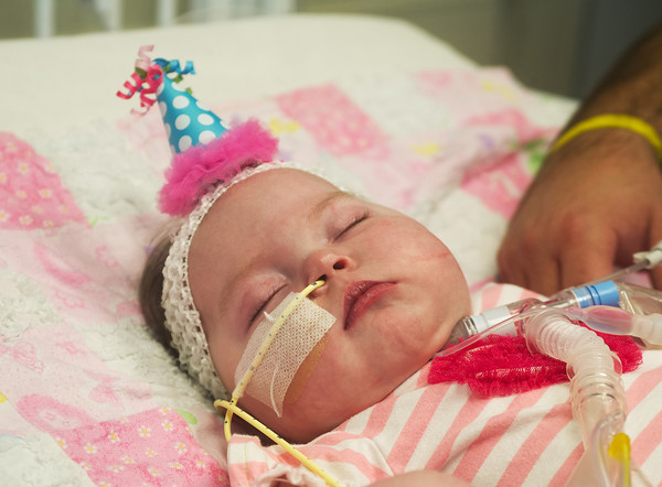 Globe/Roger Nomer<br /> Delylah Harris sports a special hat for her first birthday on Friday.