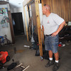 Globe/Roger Nomer<br /> Jeremy Lawyer, public works director for Sarcoxie, looks around the interior of 509 Cross on Thursday.