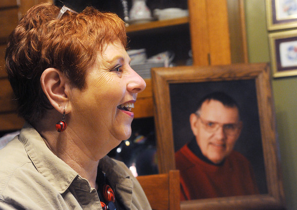 Globe/Roger Nomer<br /> Kathy Gronau talks about her husband Orin, shown in a photo behind her.