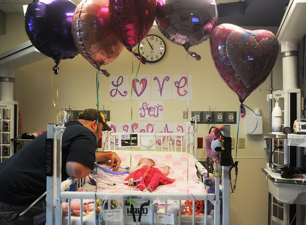 Globe/Roger Nomer<br /> BJ Harris waits for his daughter Delylah to wake up on her first birthday as she receives treatment at Children's Mercy Hospital on Friday.