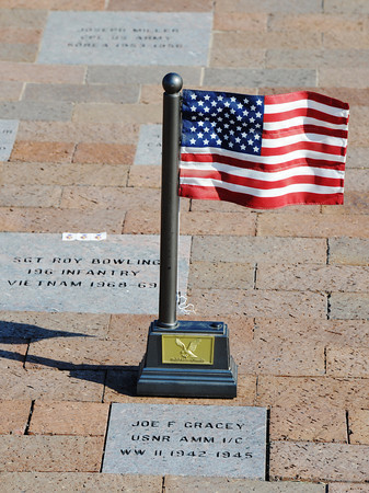 A small US flag honors Joe F Gracey, Sept. 9, 2013, at the PSU Veterans Memorial Amphitheater in Pittsburg, Kan. Gracey served for three years during World War II.<br /> Globe | T. Rob Brown