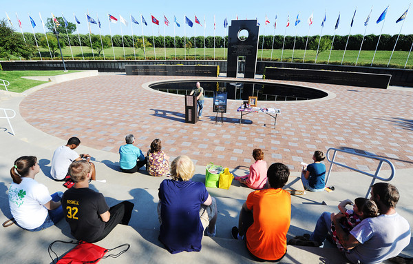 Speech students listen to classmate and former U.S Marine as he talks about his service in Iraq and Kuwait, Sept. 9, 2013, at the PSU Veterans Memorial Amphitheater in Pittsburg, Kan.<br /> Globe | T. Rob Brown