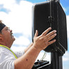 Globe | T. Rob Brown<br /> CIty of Joplin Public Works Department signal technician Doug Webb re-installs a pedestrian light Tuesday afternoon, Sept. 24, 2013, at the intersection of 2nd and Main Streets. Webb said the light had been knocked down recently.