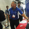 Globe/Roger Nomer<br /> Gary Mattson, human resources manager with Azzazz Atkinson, talks with Pittsburg State students on Wednesday during Company Day.