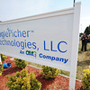 Eagle-Picher Technologies LLC representatives talk to the public Thursday morning, Sept. 12, 2013, following a groundbreaking at the Crossroads Industrial Park.<br /> Globe | T. Rob Brown