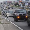 Globe/Roger Nomer<br /> Traffic moves along Range Line Road near 24th Street on Tuesday morning.