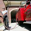 Globe/Roger Nomer<br /> Captain Taylor Cerne empties a pump truck at the Pittsburg Fire Station on Wednesday afternoon.