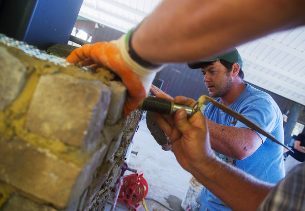 Globe/Roger Nomer<br /> Don Graziose II, with Next Generation Masonry, works on a pavilion at Claythorne Lodge on Tuesday morning.