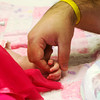 Globe/Roger Nomer<br /> BJ Harris holds his daughter Delylah's hand as she wakes up on her first birthday at Children's Mercy Hospital.
