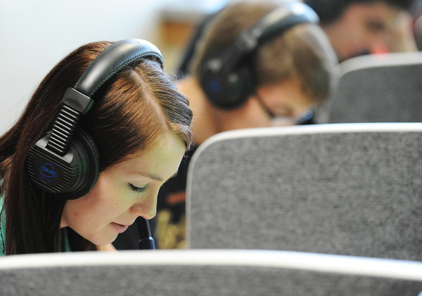 Emily Weldin, an MSSU junior biochemistry major, reads Spanish to a classmate through a headset Friday morning, Sept. 27, 2013, in the Foreign Language Lab in MSSU's Webster Hall.<br /> Globe | T. Rob Brown