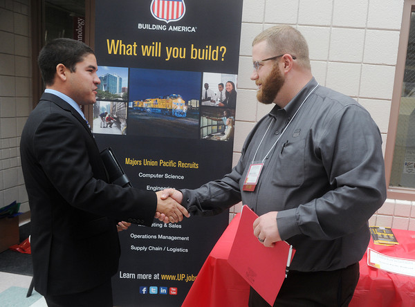 Globe/Roger Nomer<br /> Freddy Largaespada, a Pittsburg State junior from Santa Fe Springs, Calif., talks with Spencer Kelso, human resources with Union Pacific Railroad, during Company Day on Wednesday.