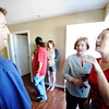 Christopher Spencer (left) of Joplin, a Rebuild Joplin Board member, speaks with new home owner Emily Morrison (right) during the Rebuild Joplin Open House for her home Thursday morning, Sept. 26, 2013.<br /> Globe | T. Rob Brown