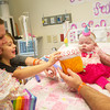 Globe/Roger Nomer<br /> Leslie and BJ Harris, along with sister Quorynn, 5, present Delylah with her birthday cupcake at Children's Mercy Hospital on Friday for Delylah's first birthday.